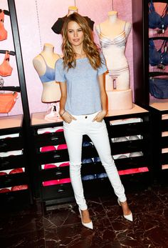 Behati Prinsloo keeps it simple in a gray t-shirt, white jeans, and pointy pumps // #Fashion #StreetStyle