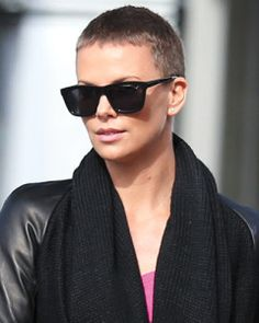 Charlize Theron hairstyles hair evolution shaved head buzz cut mad max