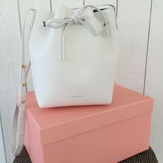 Mansur Gavriel White Mini Bucket Bag LOOKING TO TRADEthis brand new Mansur Gavriel White (coated calf with dark blue inside) Mini Bucket Bag for another bag of similar value. I bought this on the March 29 release and they sell out in minutes! It was worn one time and still in perfect condition. Comes with box, bag, and receipt! Mansur Gavriel Bags Crossbody Bags