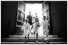 Rome, Vatican City. Bride entering the church with her father. Pages and bridesmaids lead her steps.