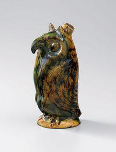 "Owl bottle, Salem, North Carolina, 1804-1840. Lead-glazed earthenware. H. 7 3/4"".  (Old Salem Museums & Gardens.) --- Art in Clay: Masterworks of North Carolina Earthenware by Old Salem Museums and Gardens, Chipstone Foundation, and Caxambas Foundation."