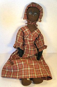 Black Cloth Doll, Painted Face, 1880, Country & Shaker Antiques, Harvard, MA.