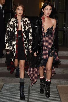 In a lace and plaid slip dress, printed neck scarf, velvet fringed coat, red and white striped socks and lace-up heeled combat boots while attending the DSquared2 Volt Party in Milan with her sister Gigi.