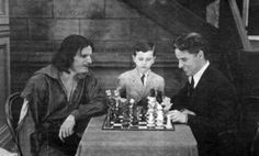 Child chess prodigy Samuel Reshevsky watches a game between Charlie Chaplin and Douglas Fairbanks on the set of The Three Musketeers, c. Charlie Chaplin, Old Movies, Great Movies, Chess Moves, Chaplin Film, Charles Spencer Chaplin, Douglas Fairbanks, Kings Game, Actresses