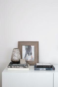 books + pottery + framed photo