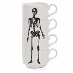 Fun! http://www.lefthandrighteye.bigcartel.com/product/stacking-skeleton-coffee-cups