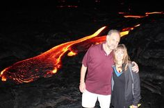"""Finally received a """"couple selfie"""" from Hawaii lava-walk of a few weeks ago. Our guide called the surface flow that night """"an A Pele greeting us with Her finest."""" . Seeing lava up close is to experience a power so intense you cannot imagine it ahead. There is a wall of thick oppressive heat that seems solid stretching outward perhaps a dozen feet/ 3-4 meters from the red river. To enter that zone requires a pushing forth. Earth is mighty Hawaii stunningly alive and breathing on every level…"""