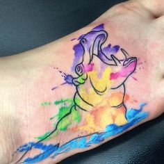 Urban Element Tattoo — Fun watercolor hippo on foot by Rowell...