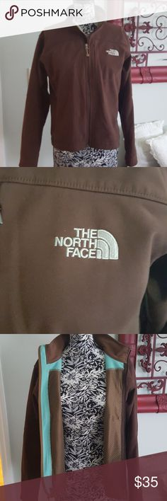 Women's The North Face jacket Women's Jacket by The North Face. Brown exterior with mint green lining.  Shell is 94% polyester and 6% elastaine. Lining 100% polyester. Great condition. Only flaw is a small spot on left sleeve at elbow The North Face Jackets & Coats