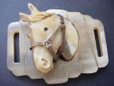 This is for an unusual vintage plastic that seems to be celluloid or possibly Bakelite horse with metal reins. It is from an estate sale and appears undamaged.