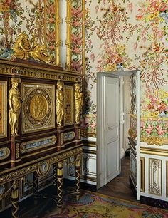 Jewelry Armoire The jewelry armoire at left, designed by Ferdinand Schwerdfeger for Marie Antoinette and decorated with bronzes by Pierre-Philippe Thomire, arrived at Versailles in 1787, two years before the start of the French Revolution.