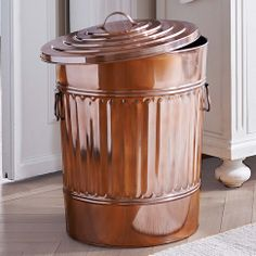 Copper garbage can    cover plain can with copper sheeting, if I can't find something like this.
