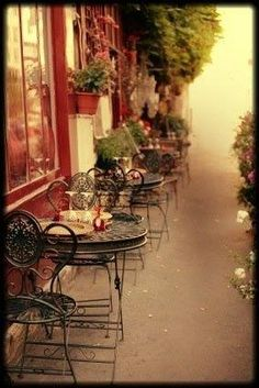 Paris cafe in rain - I love these chairs, for my kitchen!