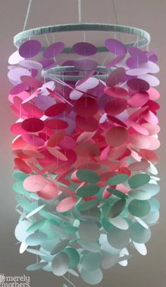 Can you believe this mobile is made mostly out of paper? Best of all, you can customize it with your favorite colors!