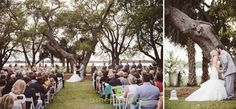 """Saying """"I Do"""" with these huge oak trees behind them at Lowndes Grove Plantatiorn @pphgcharleston Flowers by @saraygrimshaw Draping by @Loluma  Wedding coordination and design by @charlestonevent"""