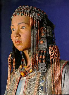 Mongolian woman's headdress of silver and red coral | Mongolian costumed mannequin in the National Museum, Copenhagen, Denmark. Danish ethnographer Henning Haslund-Christensen collected these artefacts in 1936-37 during his visit to Mongolia on behalf of the National Museum of Denmark. | ©Miguel C, via Flickr