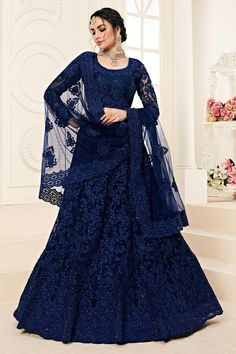 Apart from bridal purpose, the undertones & dark shades of blue lehenga choli are versatile to be worn on many occasions like sangeet, engagement, etc. Check out of the designer collection of lehenga choli at Trendybiba. Heavy Lehenga, Net Lehenga, Indian Lehenga, Lehenga Gown, Lehenga Style, Party Wear Lehenga, Bridal Lehenga, Indian Dresses, Indian Outfits