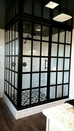 "GRIDSCAPE SERIES GS1 ""STEEL"" FRAMED CUSTOM SHOWER DOOR WITH TRUE DIVIDED LIGHT GLASS PANES. BLACK/BRONZE - CLEAR INSTALLED ON WHITE SUBWAY TILE SETTING AND GLOSS BLACK CEILING BY COASTAL SHOWER DOORS www.coastalshowerdoors.com"