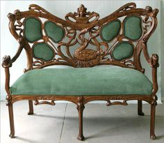Art nouveau settee ~ French 19th century carved Art Nouveau settee.