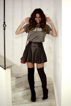 Black vegan leather skirt with inverted pleats worn with grey T-shirt with white text and black over the knee boots.. DIY the look yourself: http://mjtrends.com/pins.php?name=black-vegan-leather-material-for-skirt