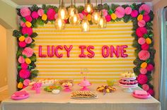 Pineapple First Birthday Party Ideas - love the flamingos and luau vibe of this sweet party!