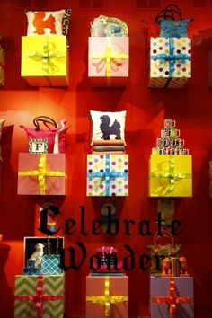 C. Wonder, New York Wrapped gift boxes serve as shelving in this creative store window! Display #eyewear on or in gift boxes for the holidays. #merchandising