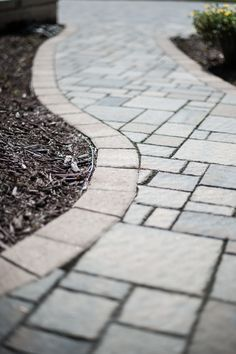 Walkway crafted with GrandCay Cobbled pavers by Eagle Bay.