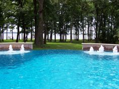 Customize one of your edges and turn your pool into an infinity negative edge pool. Infinity pools create the illusion and impression that the pool's edge vanishes and merges into its natural landscape. If your property sits out near a lake or beach, this option is a must-have. Some of the world's most famous pools include a vanishing edge. #spas #swimmingpools #infinitypool #NegativeEdge #custompoolshouston #platinumpoolstexas