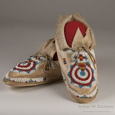 "Cheyenne woman's pair of moccasins with the ""keyhole"" design. The beadwork is…"