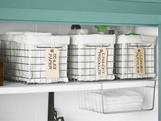 In a closet, use lined bins to conceal cleaning supplies and toilet paper. Also, we love this under-shelf bin from The Container Store to milk every square inch of space for storage. Only $6.99! #storage #organization