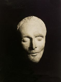 Death Mask of Amedeo Modigliani - photo by Man Ray (1930). you see all the faces in his paintings in his visage.