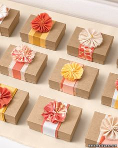 Wrap a small box with a belt of layered ribbons or a strip of woven fabric, and cap it off with a single fabric blossom.