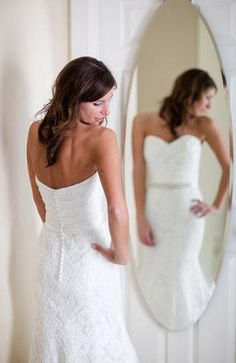 Wedding photo idea: bride in a full length mirror so you can see front and back of the gown in the same picture.