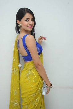 Looking for best contrast blouse ideas to try with yellow saree? Here are 13 pretty colors that can add whole lot of charm to your vibrant yellow sarees! Indian Blouse Designs, Blouse Back Neck Designs, Saree Wearing Styles, Saree Styles, Sarees For Girls, Saree Backless, Saree Poses, Yellow Saree, Saree Photoshoot