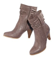 """Leatherlike upper. Side zip. Faux-wood heel, 3"""" H. Skid-resistant sole. Whole sizes only. Half sizes, order one size up."""