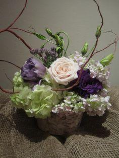 Table centerpieces - curly willow, Sahara roses, green apple hydrangea, lavender hydrangea, green lisianthus, purple lisianthus, misty flowers in birch bark vase courtesy of Haumea Designs