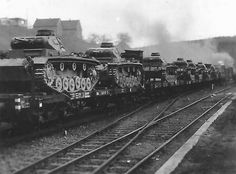 A large number of Panzer 3 tanks being transported by military ordinance train
