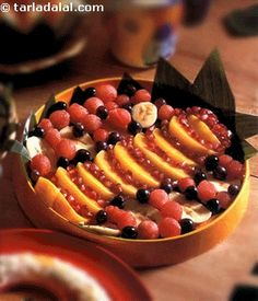 A different fruit salad with cheese balls.