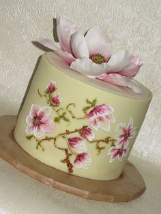 The brush embroidery is so beautiful, I almost didn't look at the sugar flower. Also love that wrap-around fondant technique