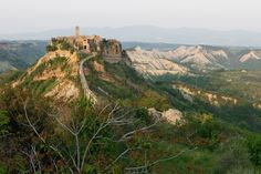 CIVITA DI BAGNOREGGIO  This gem of a town is one of the most striking sights in Italy! Civita di Bagnoregio suffered an earthquake in the 17th century that was so devastating, much of the town collapsed, leaving only the small section you see here. (Even the home of Saint Bonaventure, who was born here, fell off the edge of the cliff). The town's isolation means it has only a handful of residents today, but it's well worth seeing for its beauty.