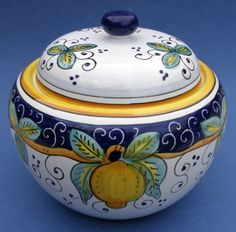 """This brightly designed Limone Italian ceramic biscotti jar is ideal to use to store biscotti or your homemade cookies. Made in Deruta, Italy, famous for Italian Majolica Ceramics and Pottery. This 2 1/4 quart (72 oz.) handmade hand painted authentic Limone biscotti jar measures 7 """" in diameter and 7 """" in height.    With every ceramic shipment, you will receive information about the history, making and care & usage of this hand made handpainted authentic Italian ceramic...."""