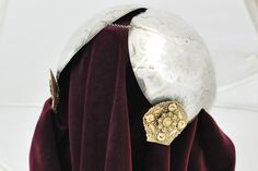 Old Dutch style costume jewelry: silver cap with gold