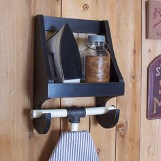 Handmade Ironing Board Shelf ~ Original Design by Sawdusty Add loads of Charm to the Laundry room with this Primitive Ironing board Shelf! Holds a modern day Ironing board with the T-shaped Pole at the top. ( I have created my own version to simply show the T-Bar style ).  The shelf above will hold your Iron and perhaps a jar of your favorite Washing Soda :) It has 2 holes, neatly drilled, in the back piece to hang it by. ★ The beaded back panel shown has been discontinued ~ I can no longer…