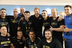 Prince Harry Photos - Prince Harry poses with Romania's Team athletes during a pre Invictus Gamestraining session at Pan Am Sports Centre on September 22, 2017 in Toronto, Canada. - Invictus Games Toronto 2017 - Pre-Event