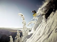 Lynsey Dyer drops through the backcountry near Mustang Powder Lodge, British Columbia. @DavidLymburn
