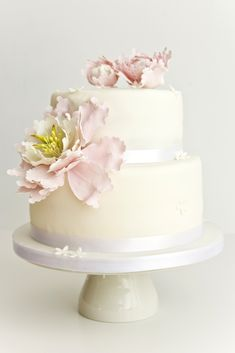 Peony sugar flower Wedding cake...this is a cake i want for my wedding...the pink in the cake is one of the colors im going to use.  its called, blush.  blush & mercury are my wedding colors.  mercury is a light greyish silver.  blush is like the pink on that cake...this cake is amazing.  simple yet classic & beautiful....love