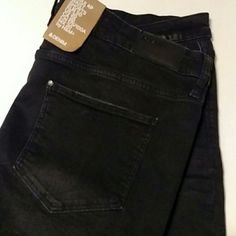 H & M Regular Waist Shorts Slightly faded black denim shorts. These are rolled at the bottom and stitched on each end so they can't be unrolled. H&M Shorts Jean Shorts