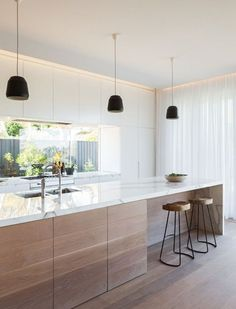 Love the natural wood + marble countertop.