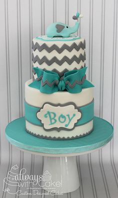 Just a basic chevron cake with a cute little elephant topper. Wasn't so easy, getting those little ballons in the trunk. :-) Elephant is made out of gumpaste.
