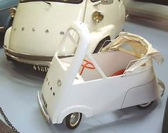 Vintage pedal car based on micro cars from the 1950's.